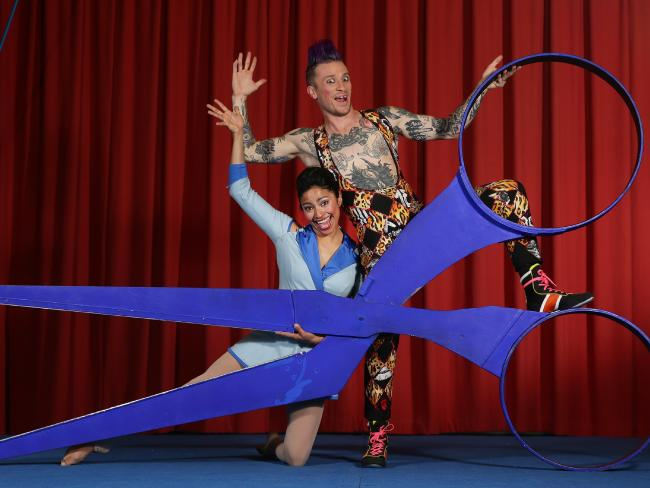 Giant scissors are just part of the fun when Tania Cervantes-Chamorro and Mitch Jones (Captain Ruin) get snipping in the circus act. Picture: Andrew Tauber